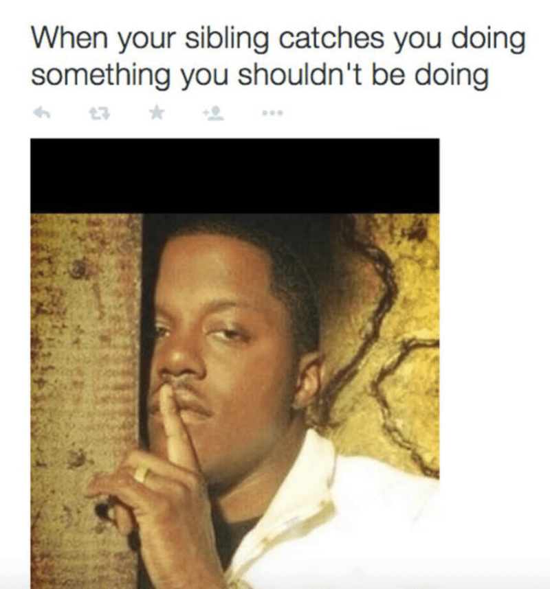 whispering black man meme about when sibling catches you doing something you shouldn't be doing.
