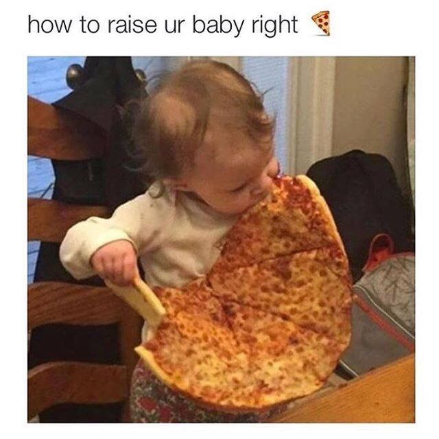 baby eating an almost entire pie of pizza