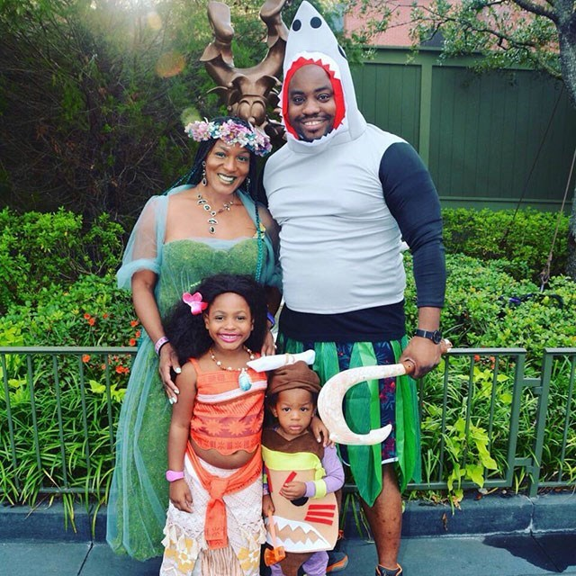 Family dressed as Disney characters