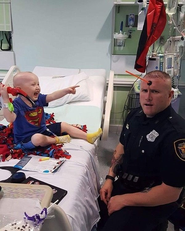 kid playing with cop in hospital