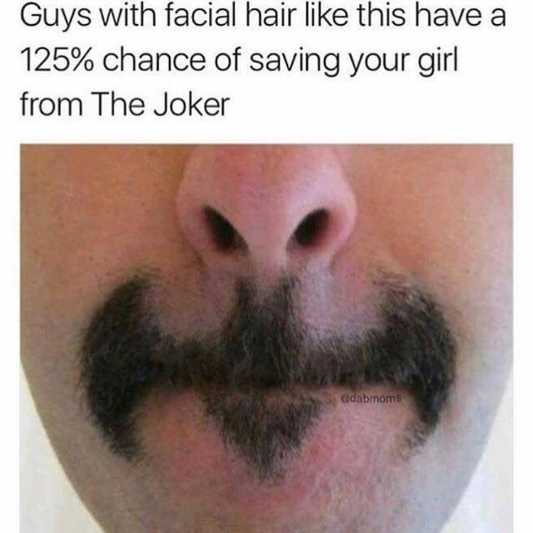 Funny meme of a man with a mustache that looks like the batman symbol.