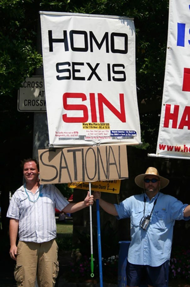 Protest - HOMO SEX IS CROSS AT CROSS SIN HA НА Mary WhePla E ST www.h SATONAL Church