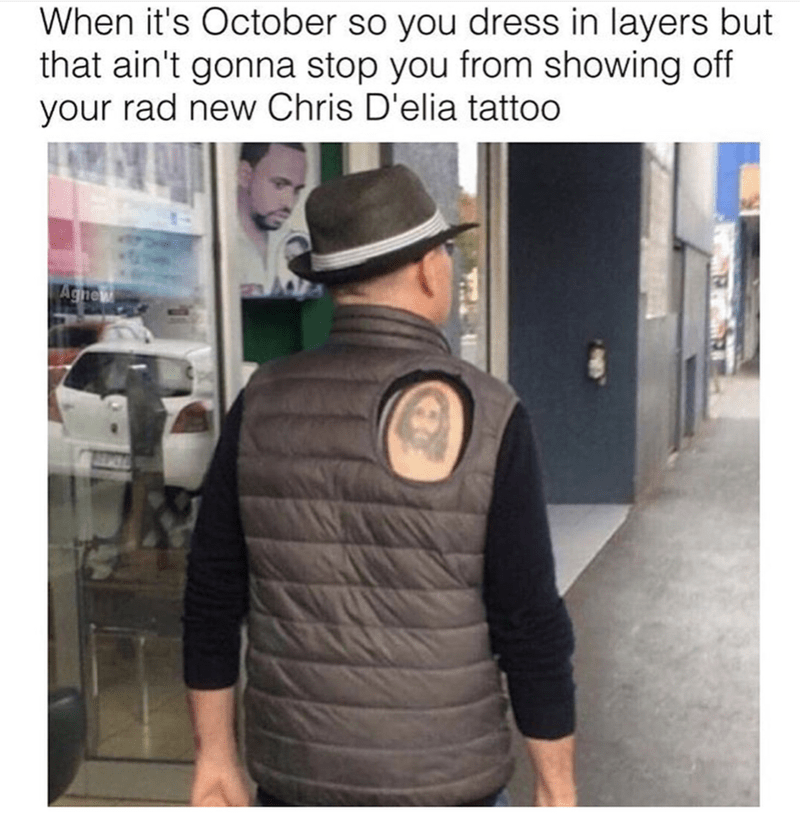 Man wearing vest with whole in it to show off his Chris D'elia tattoo