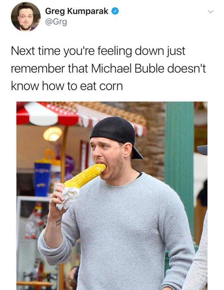 Funny meme about how Michael Buble doesn't know how to eat corn.