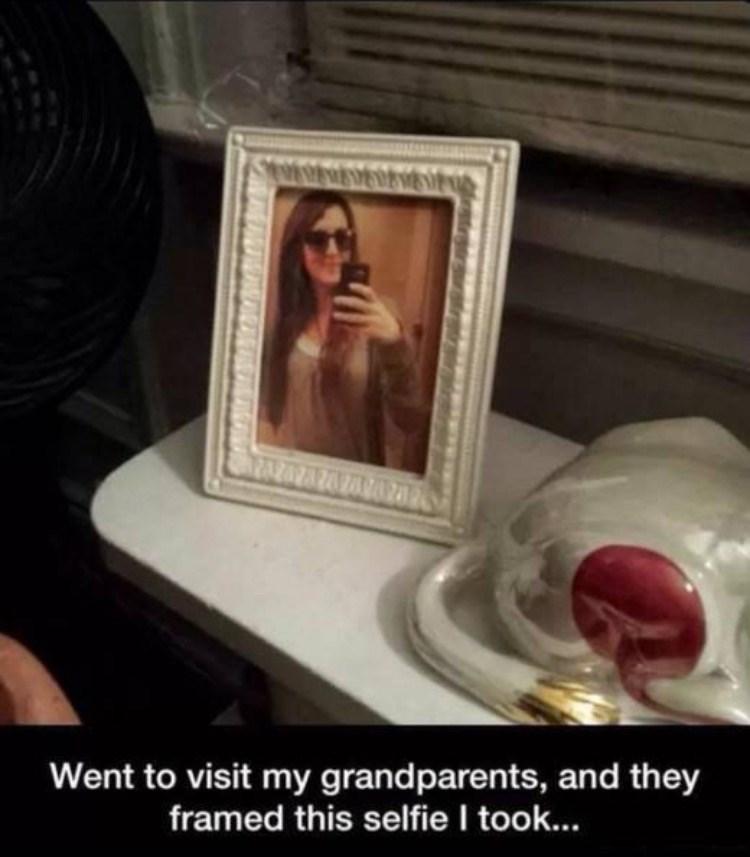 Funny meme of girl who's grandparents framed a selfie she took