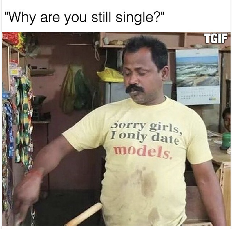 Dude wearing shirt that says Sorry Girls, I only date models