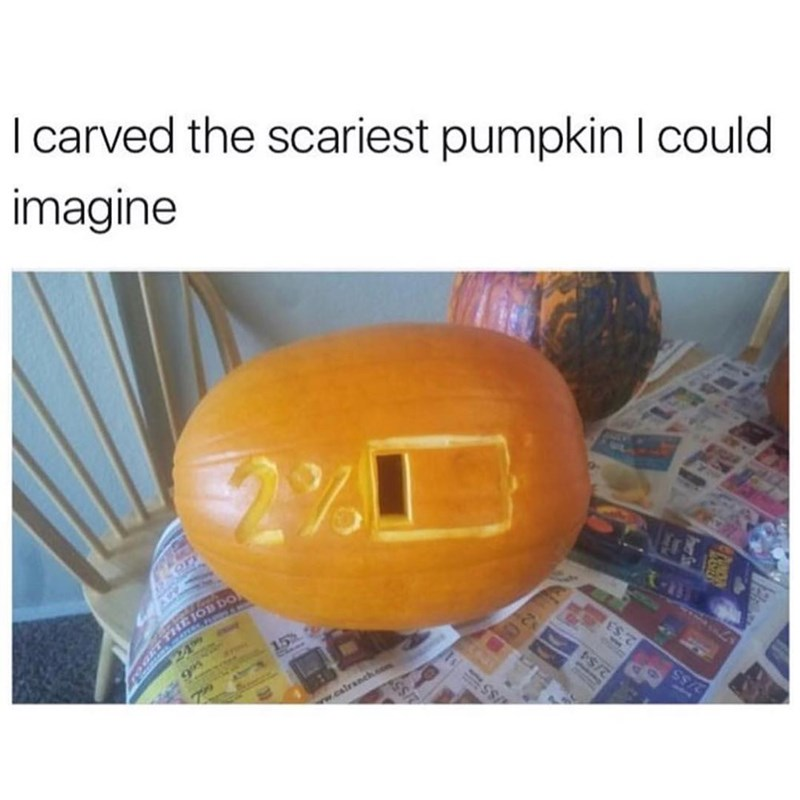 Funny meme about carving a scary pumpkin for halloween, pumpkin is carved as a 2% battery.