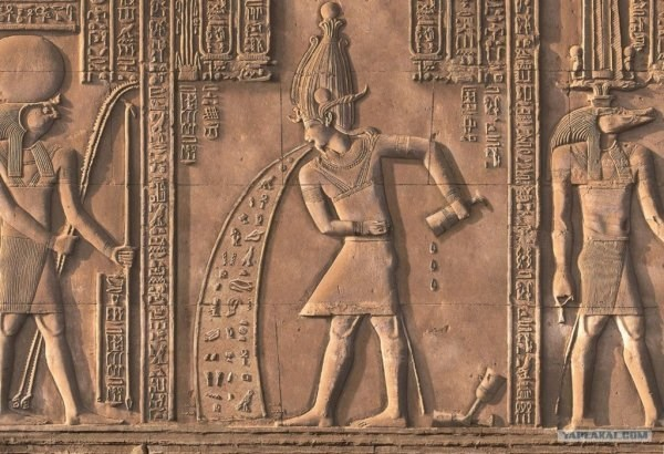 drinking meme with hieroglyph that appears to depict person throwing up after drinking