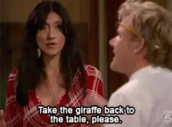 Facial expression - Take the giraffe back to the table, please.