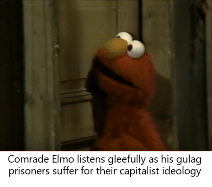 dank sesame - Photo caption - Comrade Elmo listens gleefully as his gulag prisoners suffer for their capitalist ideology