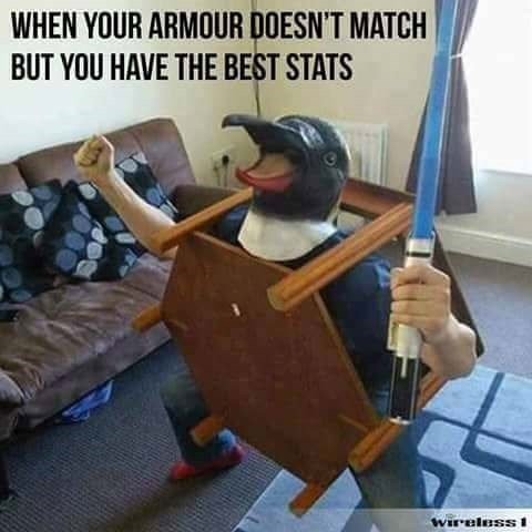 Funny meme from a picture of someone wearing a penquin head, a coffee table, and a plastic light saber and caption about when your armour doesn't match but you have the best stats.