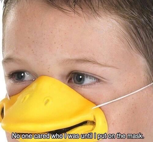 young boy wearing fake yellow duck beak