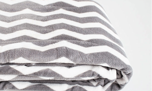 Extra soft blanket with gray and white stripes is extremely comfy.