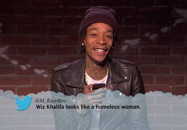 Happy - @AL RamBro Wiz Khalifa looks like a homeless woman.