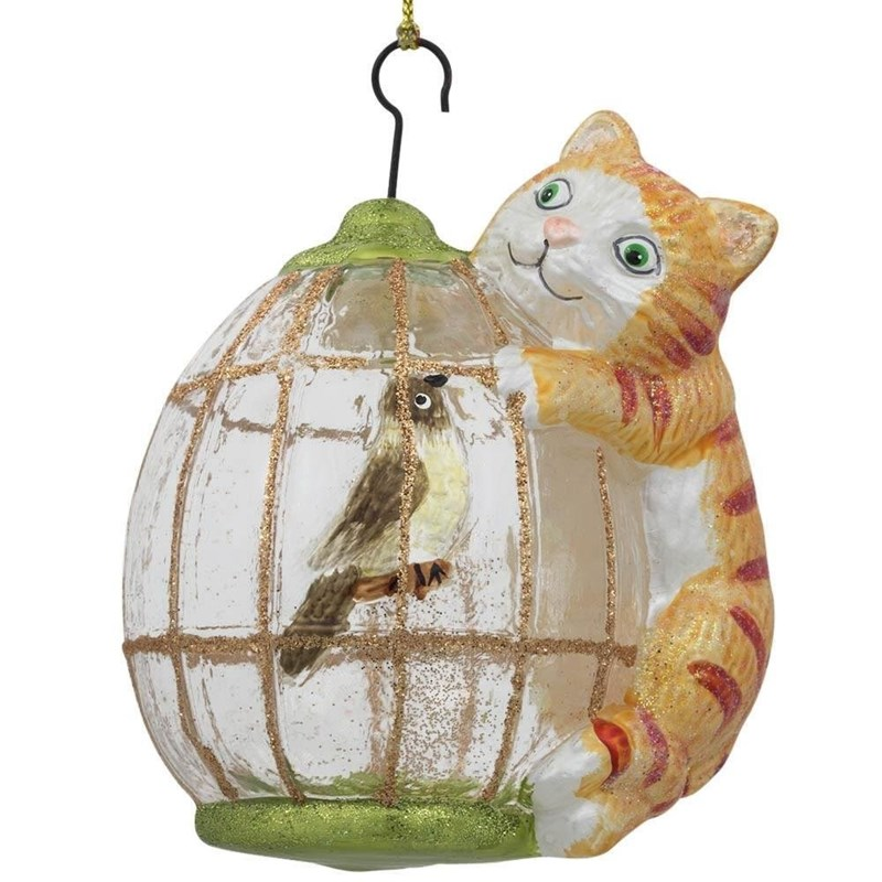 Christmas tree ornament of a cat latching onto a bird cage