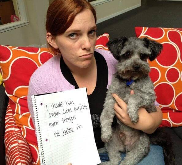 human shaming - Dog - made him Weap tute autfts even though he hates it