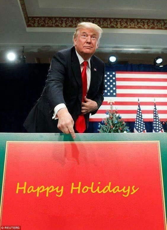 Trump meme of him pointing at a Happy Holidays sign