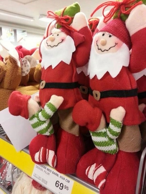 Christmas design fail of a Santa stuffed doll performing a sexual act