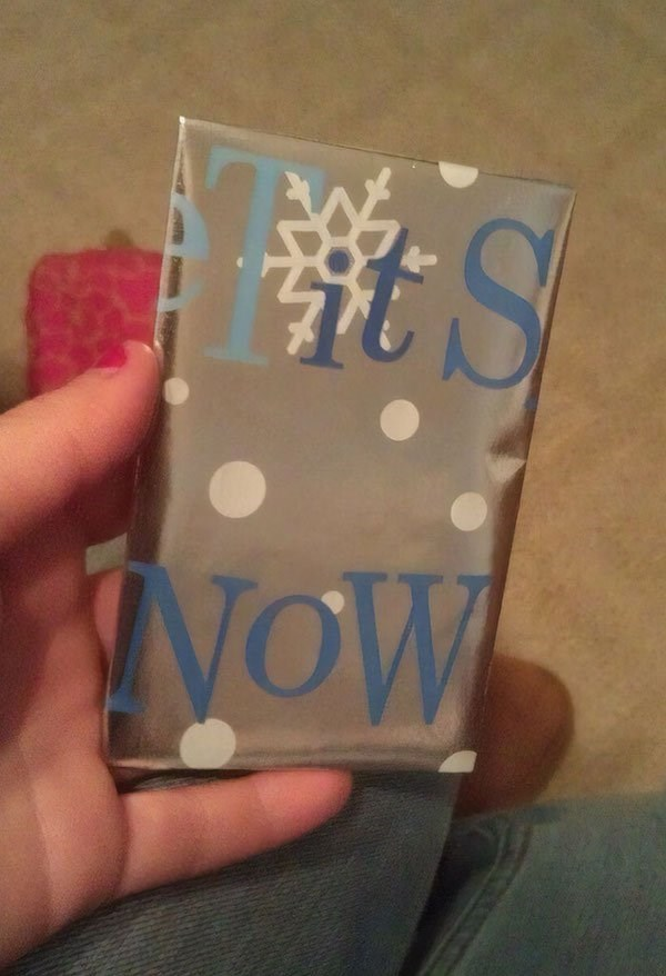 "Christmas design fail of present wrapping that says ""tits now"""