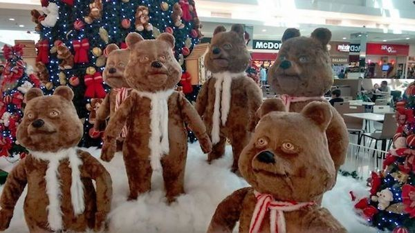 Christmas design fail of holiday bears in a retail store all looking weird