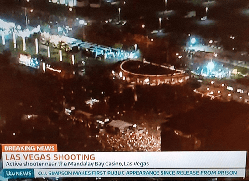 news ticker about O J Simpson getting out of prison during report on Las Vegas shooting