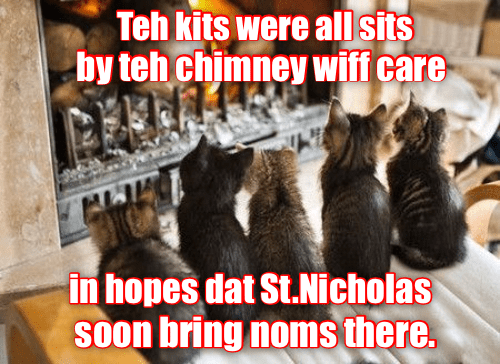 Photo caption - Teh kits were all sits by teh chimney wiff care in hopes dat St.Nicholas SOon bring noms there.
