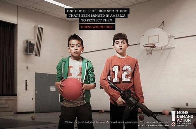 Basketball - ONE CHILD IS HOLDING SOMETHING THAT'S BEEN BANNED IN AMERICA TO PROTECT THEM GUESS WHICH ONE 12 MOMS DEMAND ACTION FOR GUN SENSE We ban the game dodgeball because it's viewed as beng too violent. Why not assault wespons? IN AMERICA MOMSDEMANDACTIONORG