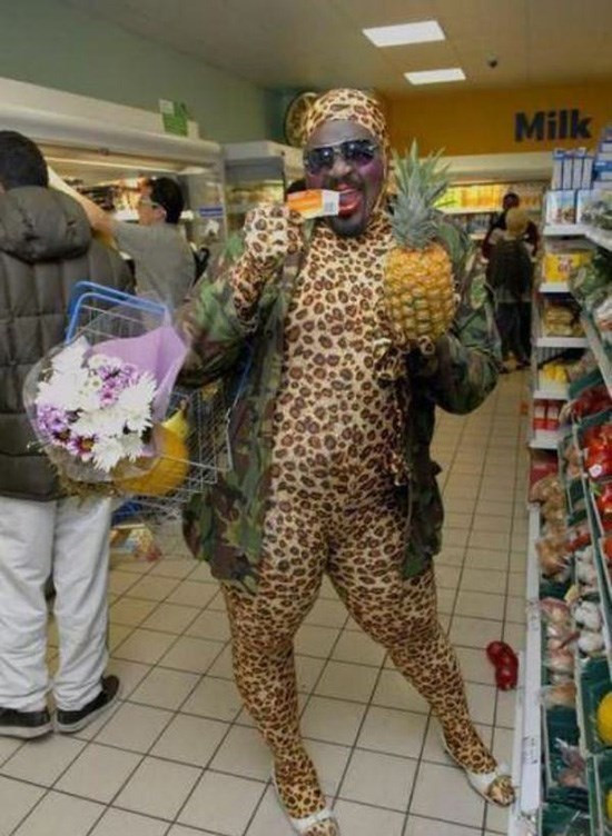 man in tight leopard outfit with shopping basket holding pineapple people of walmart memes