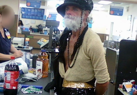 man wearing open chested shirt hat beads and glittery pants people of walmart memes