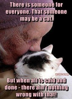 Photo caption - There is someone for everyone. That someone may be a cat. But when all issaidand done-there ain tnothing wrong with that