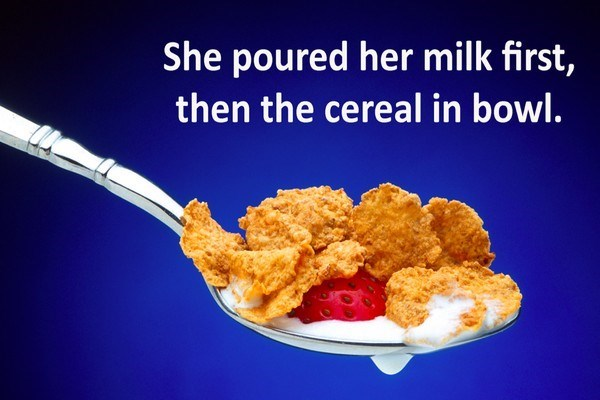 Food - She poured her milk first, then the cereal in bowl.