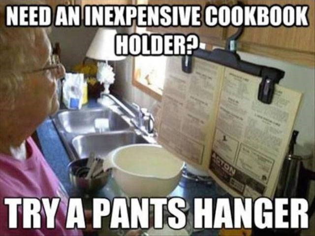 Photo caption - NEED AN INEXPENSIVE COOKBOOK HOLDER? ASTON TRY A PANTS HANGER