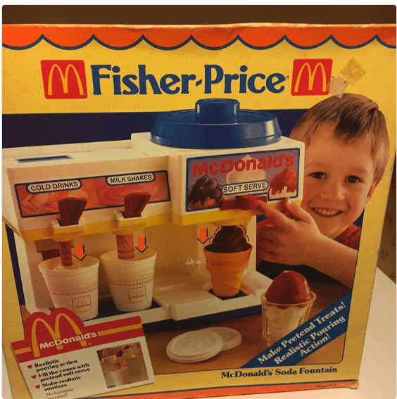 Toy - MFisher-Price M COLD DRINKS MILK SHAKES McDonalds SOFT SERVE McDonald's Realistic poaring action VFill the cones with pretend solt serve Make realistic swndaes Nobatheries sored Make Pretend Treats! Realistic Pouring Action! McDonald's Soda Fountain