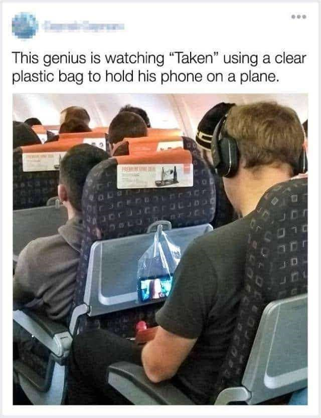 """Product - This genius is watching """"Taken"""" using a clear plastic bag to hold his phone on a plane."""