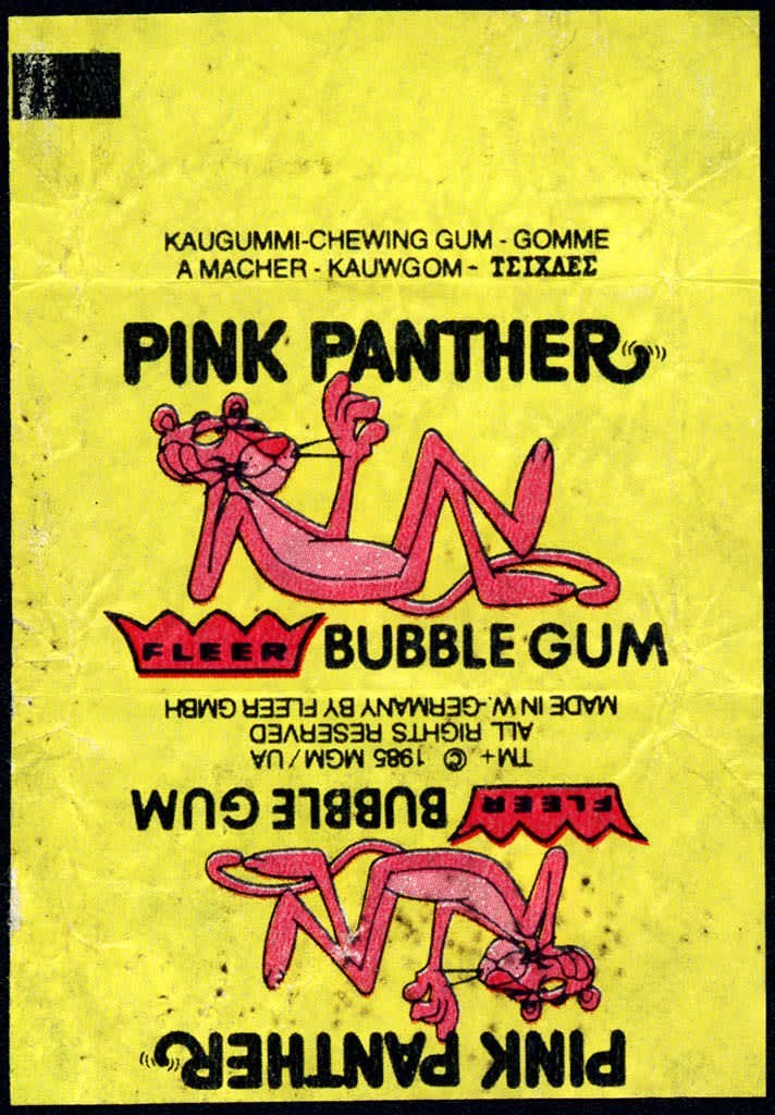 Text - PINK PANTHER BUBBLE GUM TM+ ©1985 MGM/UA ALL RIGHTS RESERVED MADE IN W.-GERMANY BY FLEER GMBH ELEER BUBBLE GUM PINK PANTHER A MACHER- KAUWGOM- TEIXAEE KAUGUMMI-CHEWING GUM GOMME