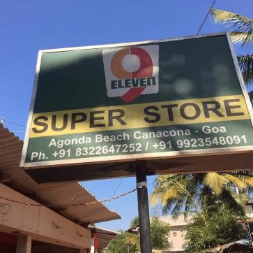 Sign - ELEVEN SUPER STORE Agonda Beach Canacona-Goa Ph. +91 83226472 52/ +91 9923548091