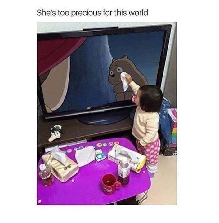 happy meme with picture of baby girl wiping tears of crying character on TV