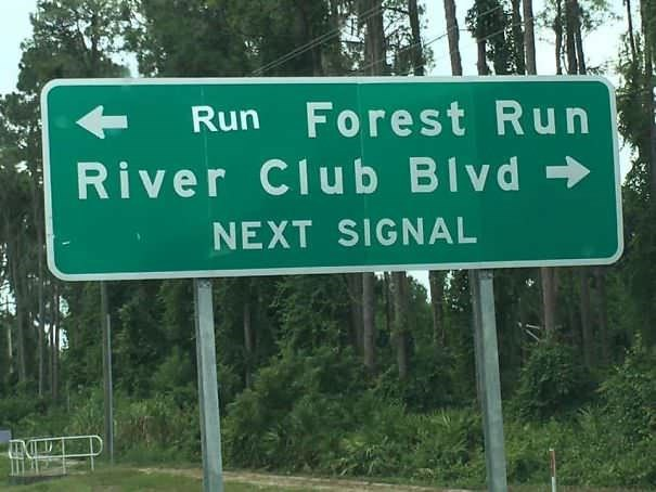 funny vandalism - Street sign - Run Forest Run River Club Blvd NEXT SIGNAL