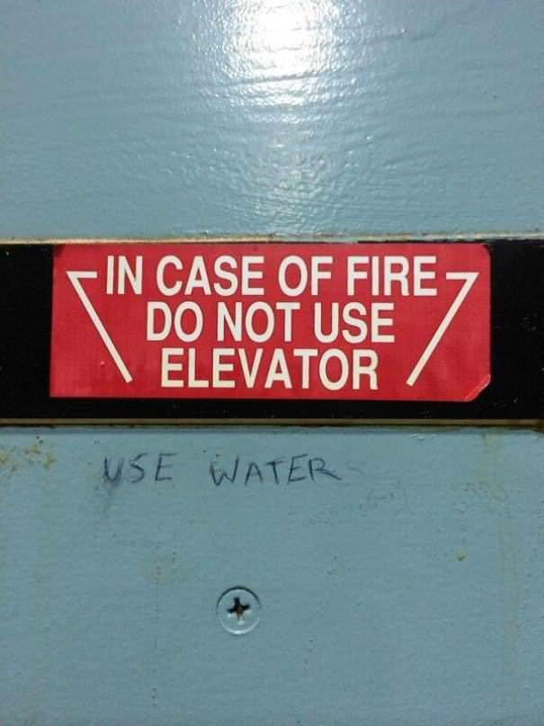 funny vandalism - Text - IN CASE OF FIRE DO NOT USE ELEVATOR uSE WATER