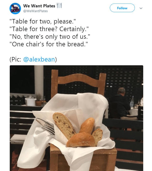 """Product - We Want Plates Follow PLATES@WeWantPlates """"Table for two, please."""" """"Table for three? Certainly."""" """"No, there's only two of us."""" """"One chair's for the bread."""" (Pic: @alexbean)"""