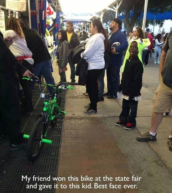 Public space - My friend won this bike at the state fair and gave it to this kid. Best face ever.