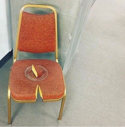 cursed image - Orange chair witha slice taken out of it and served as cake