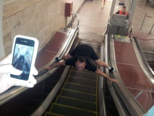 cursed image - Escalator splits and filming it