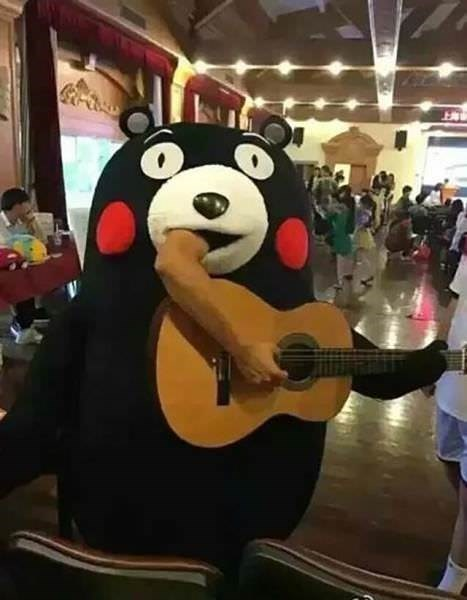cursed image of a mascot playing a guitar by sticking his hand out the mouth