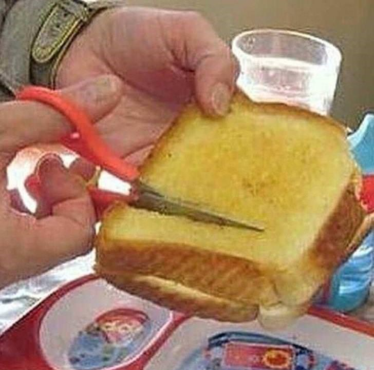 cursed image - Junk food being cut with sewing scissors