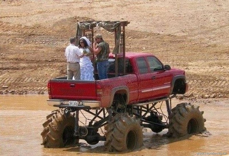 wedding taking place in the trunk of a monster truck