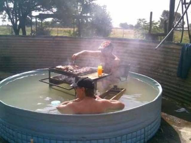 redneck man grilling inside of a hot tub