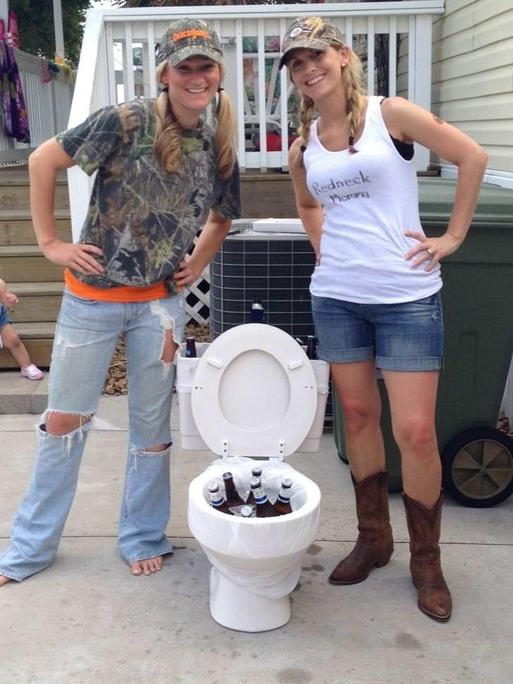funny picture of redneck girls posing with a toilet full of beer