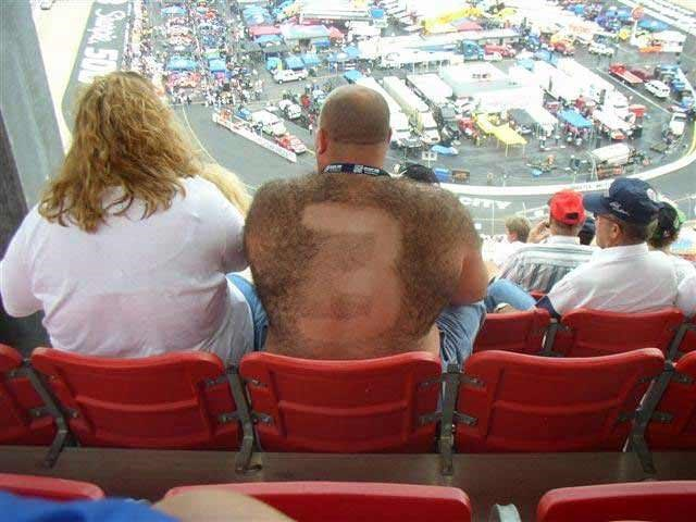 funny picture of redneck watching racing event with a shape shaved into his back hair