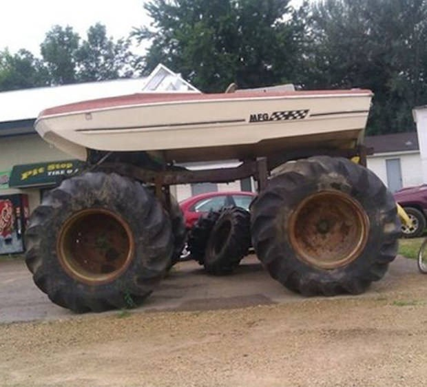 picture of boat placed on top of monster wheels